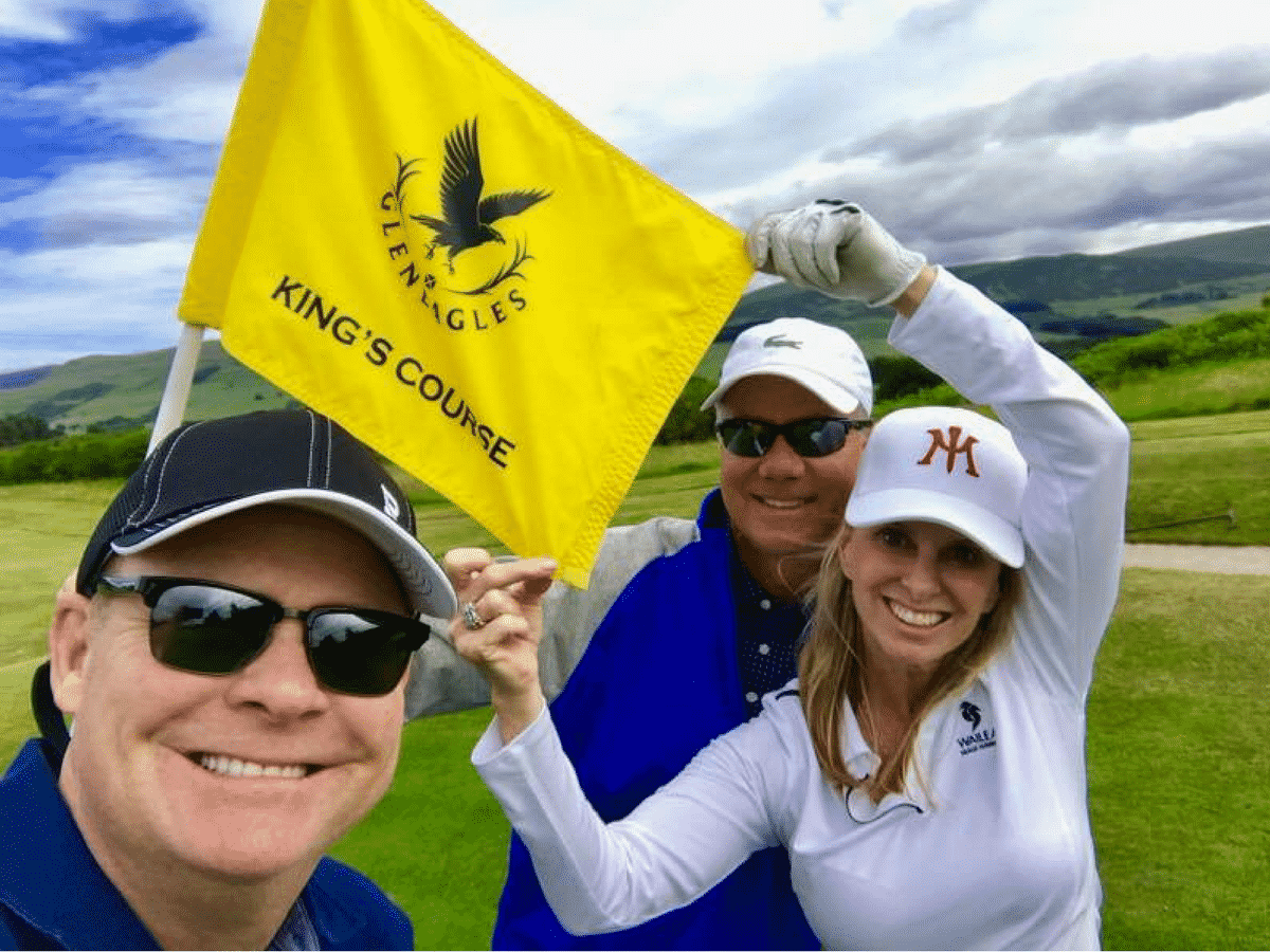 Leslie With King's Course Flag